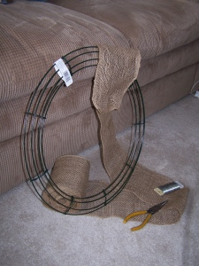 My supplies for step one: wreath frame, burlap, wire and wire cutters.